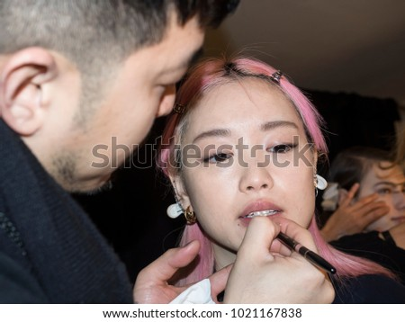 New York, NY, USA - February 8, 2018: A model prepares backstage for Noon by Noor Fall/Winter 2018 runway show during New York Fashion Week at Spring Studios, Manhattan #1021167838