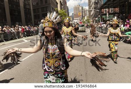 New York, NY USA - May 17, 2014: Indonisian dance group Sauna Budaya performs on 8th annual dance parade on Broadway