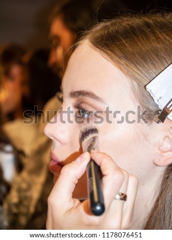 New York, NY, USA - September 6, 2018: A model prepares backstage for the Noon by Noor Spring/Summer 2019 runway show during New York Fashion Week at Spring Studios, Manhattan #1178076451