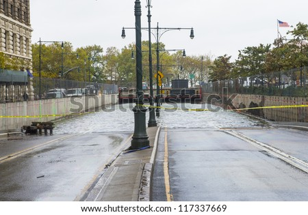 NEW YORK - OCT 30 :  Flooded road at downtown Manhattan as Hurricane Sandy aftermath  in October 30 2012 in New York.