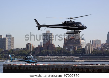 NEW YORK – OCT 8: Helicopters take off and land along the East River in lower Manhattan on October 8, 2011 in New York City.