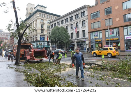NEW YORK - OCT 30 : Hurricane Sandy leaves downed trees in Manhattan streets in October 30 2012 in New York.