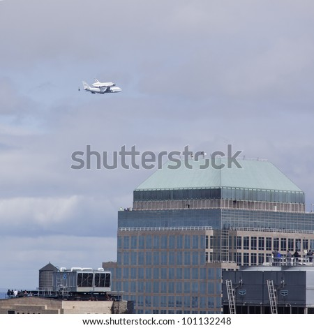 NEW YORK - Oct 8: Space shuttle Enterprise mounted on NASA's 747 Shuttle Carrier Aircraft flies north along the Hudson River with 3 World Financial Center in the foreground on October 8, 2011 in NYC. - stock photo