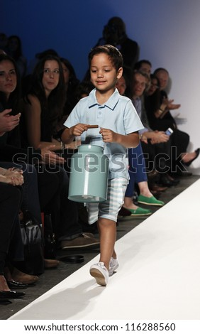 NEW YORK - OCTOBER 20: Boy model walks runway for petite Parade show collection by Zutano during kids fashion week NYC sponsored by Vogue Bambini at Industria Supertudio on October 20, 2012 in NYC