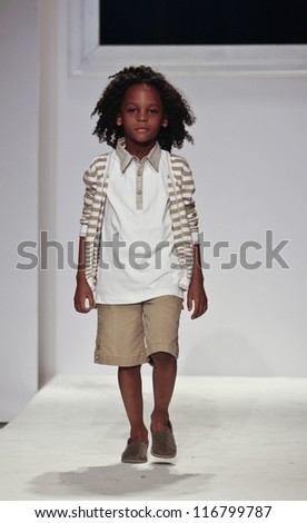 NEW YORK - OCTOBER 21: Boy walks runway for petite Parade show by Monnalisa during kids fashion week sponsored by Vogue Bambini at Industria Superstudio on October 21, 2012 in New York City