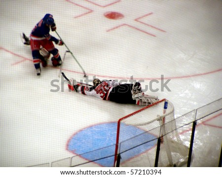NEW YORK - OCTOBER 2: Devils goalie Martin Brodeur dives and stretches to make a save against the Rangers in a preseason game at Madison Square Garden October 2, 2005 in New York, NY.