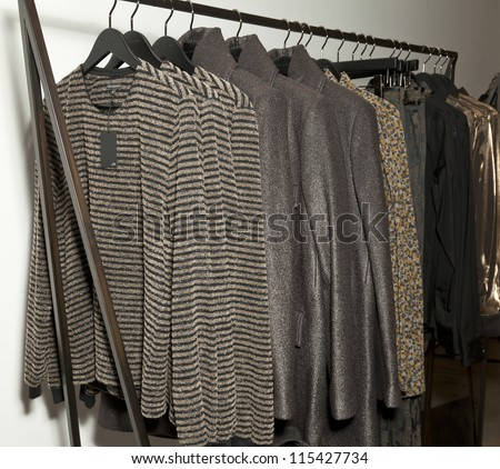 NEW YORK - OCTOBER 11: Dresses on display for opening Miguel Antoinne store and runway show in SOHO on October 11, 2012 in New York City