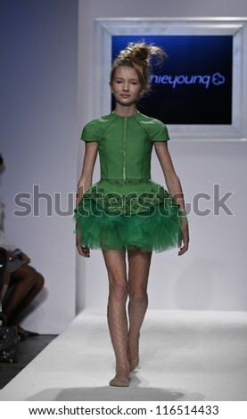 NEW YORK - OCTOBER 21: Girl walks runway for petite Parade show by Bonnie Young during kids fashion week sponsored by Vogue Bambini at Industria Supertudio on October 21, 2012 in New York City