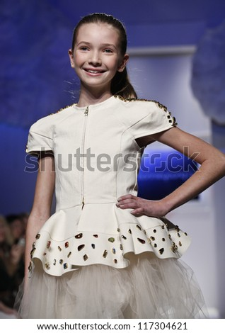 NEW YORK - OCTOBER 21: Girl walks runway for petite Parade show by Bonnie Young during kids fashion week sponsored by Vogue Bambini & Swarovski Elements at Industria Superstudio on Oct 21, 2012 in NYC