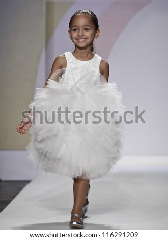 NEW YORK - OCTOBER 21: Girl walks runway for petite Parade show by Mischka Aoki during kids fashion week sponsored by Vogue Bambini & Swarovski Elements at Industria Supertudio on Oct 21, 2012 in NYC