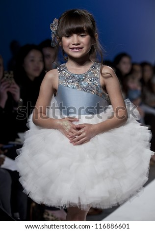 NEW YORK - OCTOBER 20: Girl walks runway for petite Parade show collection by Mischka Aoki during kids fashion week NYC sponsored by Vogue Bambini at Industria Superstudio on October 20, 2012 in NYC