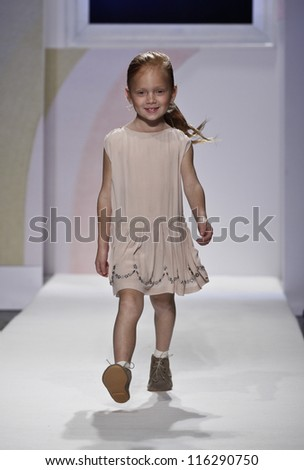 NEW YORK - OCTOBER 21: Girl walks runway petite Parade show by Caramel Baby & Child during kids fashion week sponsored by Vogue Bambini & Swarovski Elements at Industria Supertudio Oct 21, 2012 in NYC