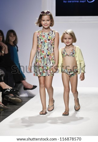 NEW YORK - OCTOBER 20: Girls model walk runway for petite Parade show collection by Baby CZ during kids fashion week NYC sponsored by Vogue Bambini at Industria Superstudio on October 20, 2012 in NYC