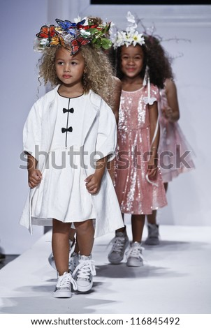 NEW YORK - OCTOBER 20: Girls walk runway for petite Parade show collection by La Piccola Danza during kids fashion week NYC sponsored by Vogue Bambini at Industria Superstudio on Oct 20, 2012 in NYC