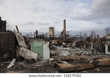 NEW YORK - October 31: Homes sit smoldering after Hurricane Sandy on October 30; 2012 in the Far Rockaway area  on October 30; 2012 in New York City; NY - stock photo