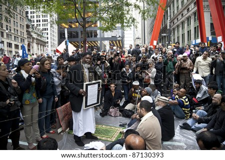 NEW YORK - OCTOBER 21: Imam Aiyub Abdul Baki of the Islamic Leadership Council leads muslims in sermon at 'Occupy Wall Street' camp in Zuccotti Park Downtown Manhattan on October 21, 2011 in New York.