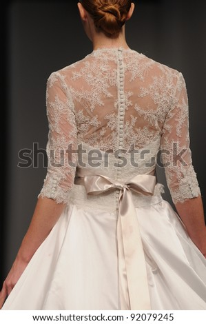 NEW YORK - OCTOBER 16: Model walking runway at the Anne Barge Bridal Collection for Spring/ Summer 2012 during NY Bridal Fashion Week on October 16, 2011 in New York, USA - stock photo