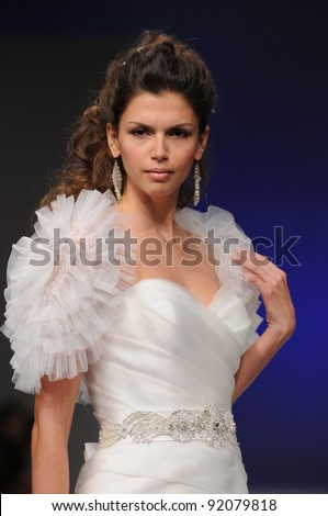 NEW YORK - OCTOBER 16: Model walking runway at the Eve of Milady Bridal Collection for Spring/ Summer 2012 during NY Bridal Fashion Week on October 16, 2011 in New York, USA