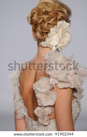NEW YORK - OCTOBER 17: Model walking runway at the Prina Tornai Bridal Collection for Spring/ Summer 2012 during NY Bridal Fashion Week on October 17, 2011 in New York, USA
