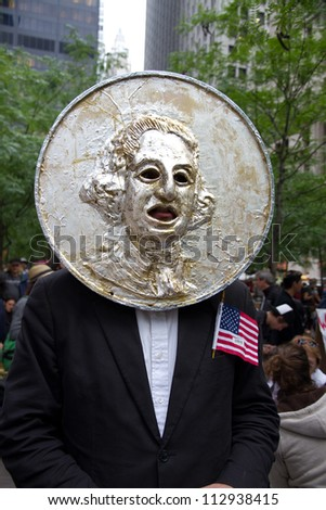 NEW YORK - OCTOBER 4: Protestors dressed as CHANGE in Zuccotti Park during the Occupy Wall Street movement.  October 4, 2011 in New York City, NY.