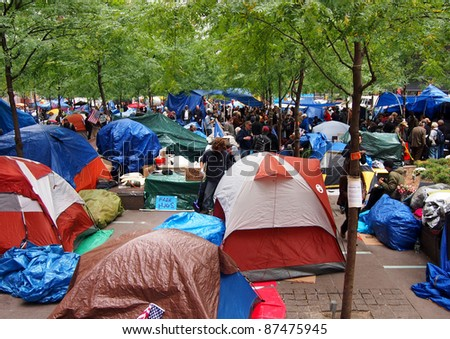 NEW YORK - OCTOBER 26: Protestors live in a tent village during the Occupy Wall Street movement, October 26, 2011 in New York City, NY. The protest against the financial system began in Zuccotti Park on September 17, 2011. - stock photo