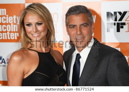 "NEW YORK - OCTOBER 16: Stacy Keibler and George Clooney attend the premiere of ""The Descendants"" at the 49th Annual New York Film Festival at Alice Tully Hall on October 16, 2011 in New York City. - stock photo"
