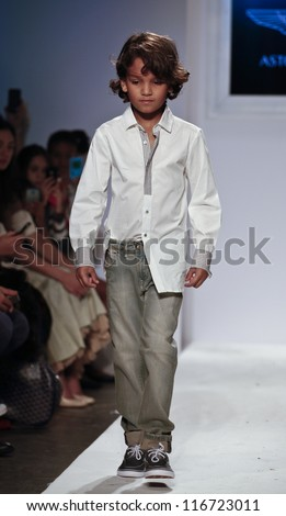 NEW YORK - OCTOBER 21: unidentified Boy walks runway for petite Parade show by Aston Martin during kids fashion week sponsored by Vogue Bambini at Industria Superstudio on October 21, 2012 in New York City