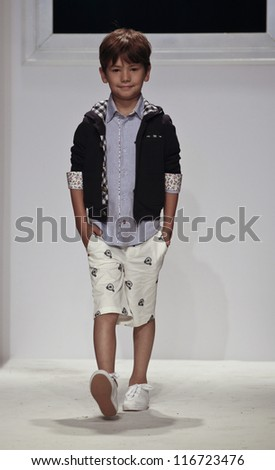 NEW YORK - OCTOBER 21: unidentified Boy walks runway for petite Parade show by Monnalisa during kids fashion week sponsored by Vogue Bambini at Industria Superstudio on October 21, 2012 in New York City - stock photo