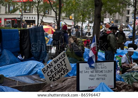 NEW YORK - OCTOBER 13: Unidentified demonstrators with 'Occupy Wall Street' camp in Zuccotti Park in Downtown Manhattan in early morning on October 13, 2011 in New York.