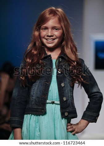 NEW YORK - OCTOBER 21: unidentified Girl walks runway for petite Parade show by Sarabanda during kids fashion week sponsored by Vogue Bambini at Industria Superstudio on October 21, 2012 in New York City