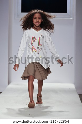 NEW YORK - OCTOBER 21: unidentified Girl walks runway for petite Parade show by Silvian Heach during kids fashion week sponsored by Vogue Bambini at Industria Superstudio on October 21, 2012 in New York City