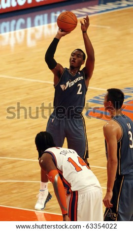 NEW  YORK - OCTOBER 17: Washington Wizards guard John Wall (2) shoots a free throw against the New York Knicks at Madison Square Garden on October 17, 2010 in New York City.