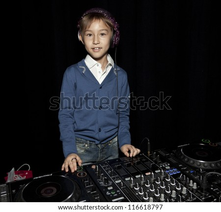 NEW YORK - OCTOBER 21: 8 years old DJ Kai Song performs at petite Parade show during kids fashion week sponsored by Vogue Bambini & Swarovski Elements at Industria Supertudio on October 21 2012 in NYC