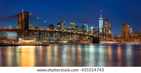 New York - Panoramic view of Manhattan Skyline with skyscrapers  and famous Brooklyn Bridge by night, big size  #435554743
