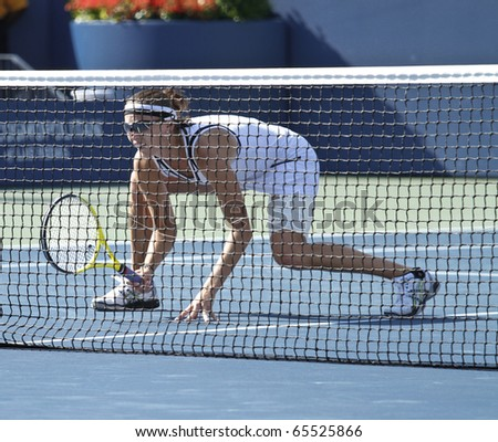 NEW YORK - SEP 13: Yaroslava Shvedova of Kazakhstan prepares for the ball during match against Nadia Petrova of Russia, Liezel Huber of USA of US Open Tennis Championship on Sep 13, 2010 in NYC