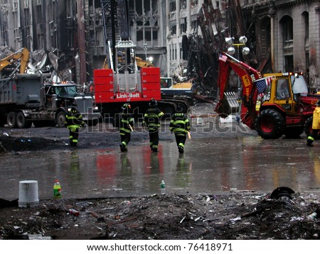 NEW YORK - SEPT 20 :  Four NYFD Fire Fighters at Ground Zero World Trade Centre on September 20, 2001 in New York.