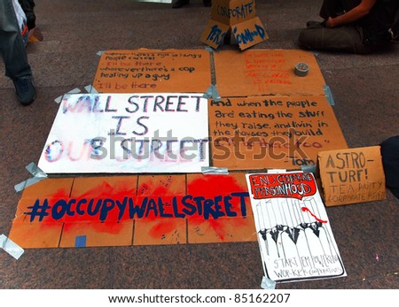 NEW YORK - SEPT. 21: Political messages are displayed at Zuccotti Park during the  Occupy Wall St. demonstration near the New York Stock Exchange on September 21, 2011 in New York City.