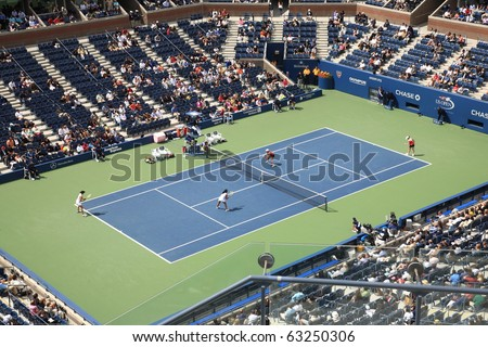 NEW YORK - SEPTEMBER 9: A crowded Arthur Ashe Stadium for a U.S. Open tennis match on September 9, 2010 in New York. In this semifinal match, King and Shedova defeat Black and Rodionava 6-3 4-6 6-4. - stock photo