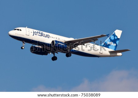 NEW YORK - SEPTEMBER 5: A320 JetBlue approaching JFK in New York, USA on September 5, 2010. A320 is biggest competition to the most popular mid-range plane 737NG Plane is wearing livery called Bubbles