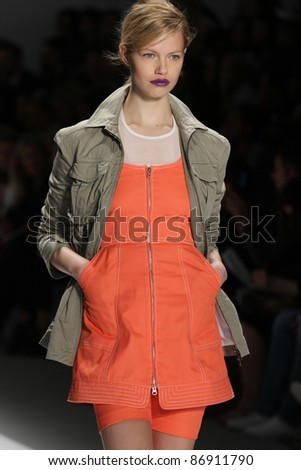 NEW YORK - SEPTEMBER 8: A model is walking the runway at the Richard Chai Collection for Spring/Summer 2012 during Mercedes-Benz Fashion Week on September 8, 2011 in New York.