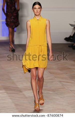 NEW YORK - SEPTEMBER 11: A model walks the runway at the Tommy Hilfiger S/S 2011 Collection during Mercedes-Benz Fashion Week on September 11, 2011 in New York City, NY.