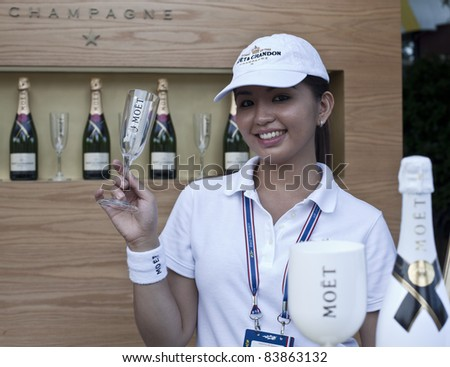 NEW YORK - SEPTEMBER 01: A server holds a glass at the food court with Moet & Chandon Champagne at US Open at USTA Billie Jean King National Tennis Center on September 01, 2011 in New York City.
