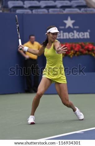 NEW YORK - SEPTEMBER 3: Ana Ivanovic of Serbia returns ball during 4th round match against Tsvetana Pironkova of Bulgaria at US Open tennis tournament on September 3, 2012 in Flashing Meadows New York - stock photo