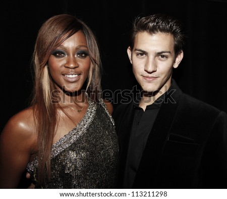 NEW YORK - SEPTEMBER 09: Artist Nick Hissom & Shontelle Layne attend runway for Zang Toi presentation during Spring/Summer 2013 at Mercedes-Benz Fashion Week on September 9, 2012 in NYC