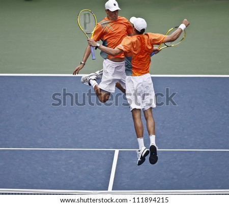 NEW YORK - SEPTEMBER 3: Bob & Mike Bryan of USA celebrate 3rd round men doubles win over Santiago Gonzalez of Mexico & Scott Lipsky of USA at US Open tennis tournament on September 3, 2012 in New York