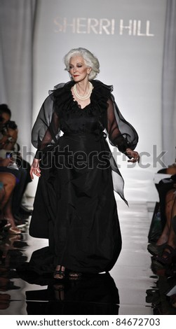 NEW YORK - SEPTEMBER 14: Carmen Dell'Orifice walks runway for collection by Sherri Hill at Mercedes-Benz Spring/Summer 2012 Fashion Week in Trump Tower on September 14, 2011 in New York City