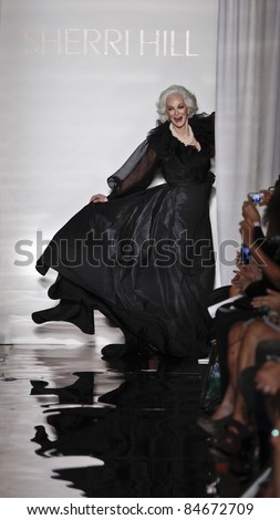 NEW YORK - SEPTEMBER 14: Carmen Dell'Orifice walks runway for collection by Sherri Hill at Mercedes-Benz Spring/Summer 2012 Fashion Week in Trump Tower on September 14, 2011 in New York City - stock photo