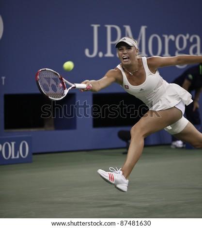 NEW YORK - SEPTEMBER 01: Caroline Wozniacki of Denmark returns ball during 2nd round match against Arantxa Rus of the Netherlands at USTA Billie Jean King National Tennis Center on Sep 01, 2011 in NYC