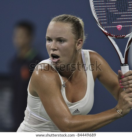 NEW YORK - SEPTEMBER 10: Caroline Wozniacki of Denmark returns ball during semifinal match against Serena Williams of USA at USTA Billie Jean King National Tennis Center on September 10, 2011 in NYC