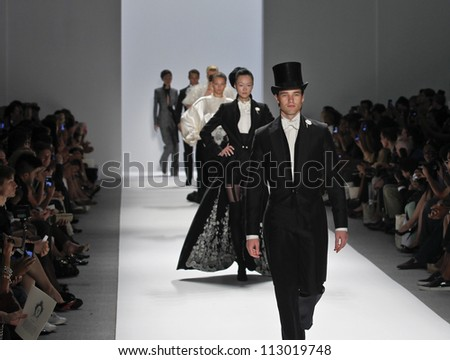 NEW YORK - SEPTEMBER 09: Dancer Cory Stearns & models walk runway for Zang Toi presentation during Spring/Summer 2013 at Mercedes-Benz Fashion Week on September 9, 2012 in NYC